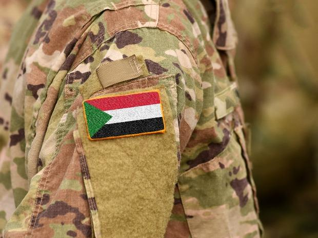Sudan flag on soldiers arm