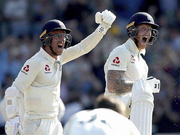 England's Jack Leach and Ben Stokes, right, celebrate victory on day four of the third Ashes cricket Test match against Australia at Headingley. Photo: AP/PTI
