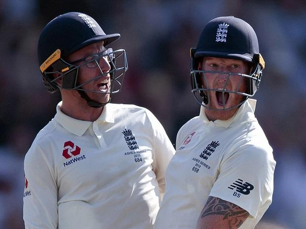 Ben Stokes, right, with Jack Leach celebrates after scoring the winning runs on the fourth day of the 3rd Ashes Test cricket match between England and Australia at Headingley cricket ground in Leeds