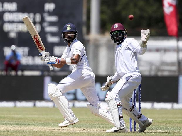 India's captain Virat Kohli that West Indies' wicket keeper Jahmar Hamilton can't catch during day one of the second Test cricket match at Sabina Park cricket ground in Kingston, Jamaica. Photo: AP/PTI