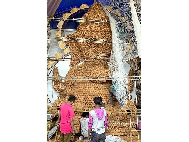 An environment friendly idol of Lord Ganesh being made out of coconuts