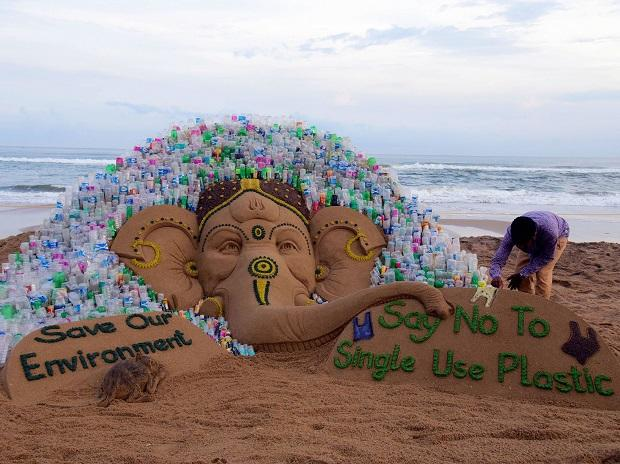 Sand artist Sudarsan Pattnaik creates a sand sculpture of lord Ganesha with a messges Say No to Single Use Plastic and Save our Environment