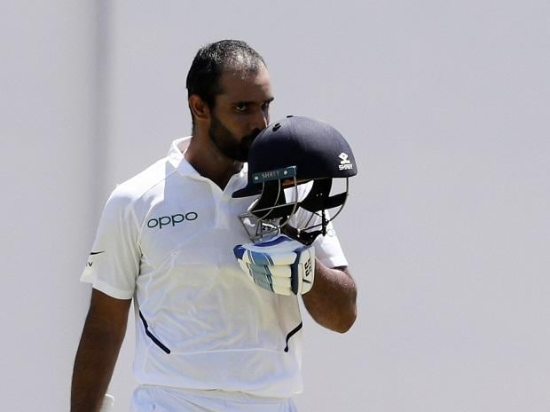Hanuma Vihari celebrates after he scored a century against West Indies during day two of the second Test cricket match at Sabina Park cricket ground in Kingston. Photo: AP/PTI