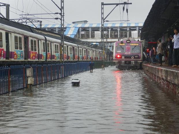 A view of waterlogged railway tracks following heavy rains in Thane. Photo: PTI