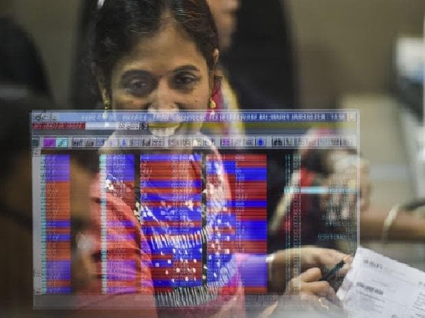 Investors react as they watch the stock prices on a digital screen, at BSE building in Mumbai, Friday, Sept. 20, 2019. Sensex surges 1,921.15 pts to end at 38,014.62; Nifty zooms past 11,200 after Finance Minister Nirmala Sitharaman announced a slew