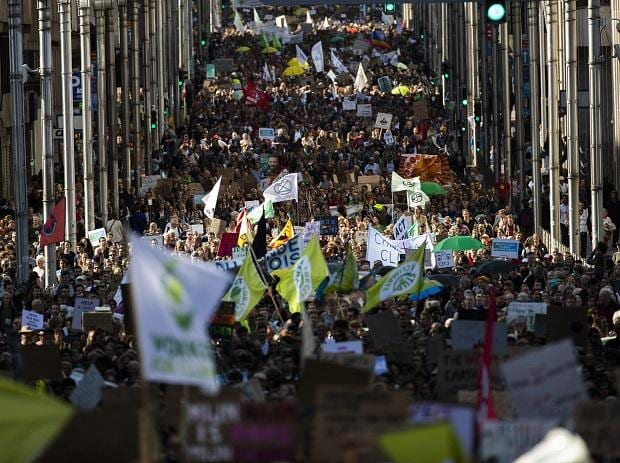 Thousands crowd main De la Loi street as they march during a climate protest in Brussels, Friday, Sept. 20