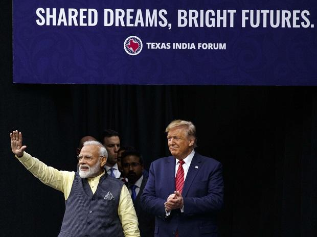 Prime Minister Narendra Modi stands on stage with President Donald Trump at NRG Stadium, Sunday, Sept. 22, 2019, in Houston, during a