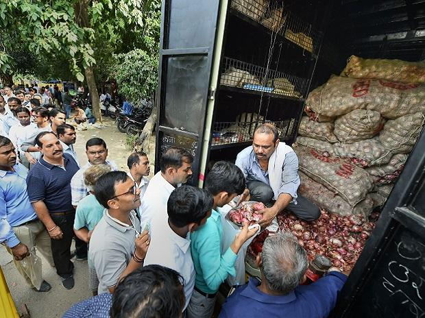 People queue up to purchase onions at subsidised rates at Krishi Bhawan. Prices have soared over the past monthPTI