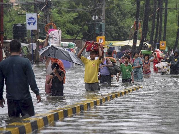 People walking in waterlogged streets of Rajendranagar in patna, Bihar | Photo: PTI