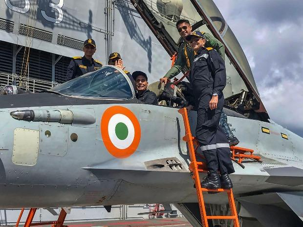 The Defence Minister seated inside a fighter jet on board the INS Vikramaditya
