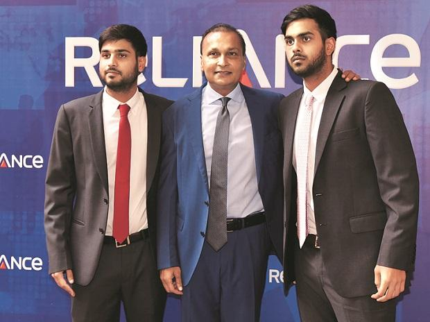 Anil Ambani, chairman, Reliance ADA Group, flanked by sons Anmol (left) and Anshul at the AGM in Mumbai 	Photo: Kamlesh Pednekar
