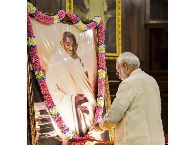 Prime Minister Narendra Modi pays tribute to Mahatma Gandhi on his 150th birth anniversary at Parliament House