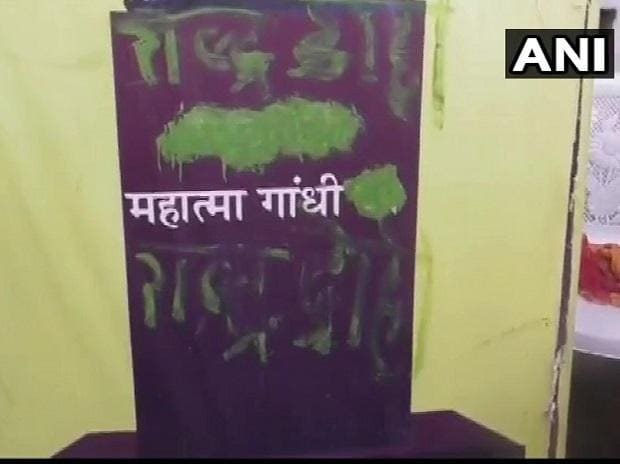 A poster of Mahatma Gandhi, at 'Bapu Bhavan' in Rewa, was found defaced (Photo: ANI)