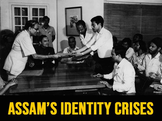 ASSAM'S TRYST: Union Home Secretary Ram D Pradhan handing over a copy of the signed accord to Assamese leaders on August 15, 1985, as Prime Minister Rajiv Gandhi (second from left) looks on. Indian Express Archive