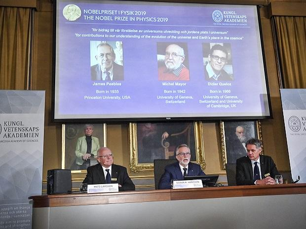 Stockholm: Goran K Hansson, centre, Secretary General of the Royal Swedish Academy of Sciences, and academy members Mats Larsson, left, and Ulf Danielsson, announce the winners of the 2019 Nobel Prize in Physics, during news conference at the Royal S