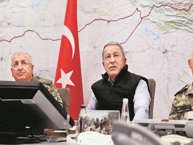 Turkish Defence Minister Hulusi Akar (centre) at army headquarters in Ankara