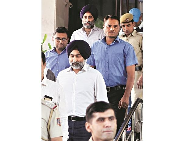 A lower court on Friday sent former Ranbaxy promoters Malvinder Mohan Singh and Shivinder Mohan Singh, and others to four days in custody of the Economic Offences Wing of the Delhi Police. Photo: Dalip Kumar
