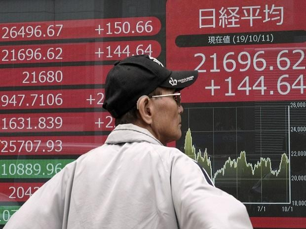Tokyo: A man looks at an electronic stock board showing Japan's Nikkei 225 index at a securities firm in Tokyo Friday, Oct. 11, 2019. Asian stock markets followed Wall Street higher Friday on optimism about U.S.-Chinese talks on ending a tariff war.