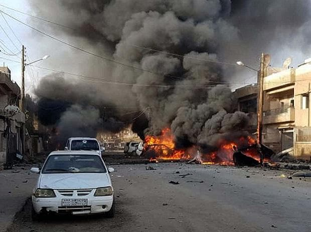 Qamishli: This photo by Hawar news, the news agency for the semi-autonomous Kurdish areas in Syria (ANHA), shows flames rising from burned cars at the site of an explosion in the central Qamishli