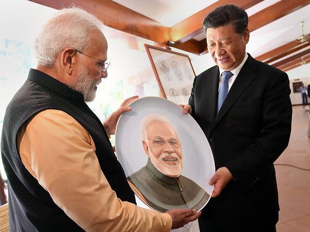 Prime Minister Narendra Modi and Chinese President Xi Jinping exchange gifts, at Mamallapuram , Saturday