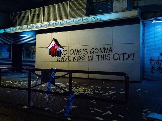 Graffiti is sprayed on the wall of the Family Planning Association of Hong Kong. Photo: Bloomberg