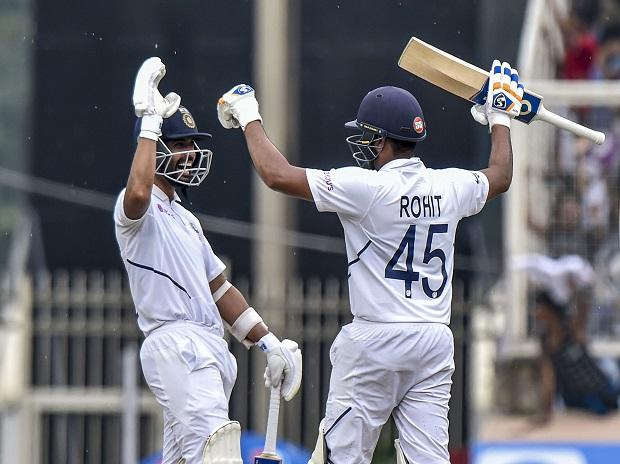 Indian cricketer Rohit Sharma celebrates after scoring 100 runs with Ajinkya Rahane during the 3rd Test match between India and South Africa at JSCA Stadium in Ranchi. File photo: PTI