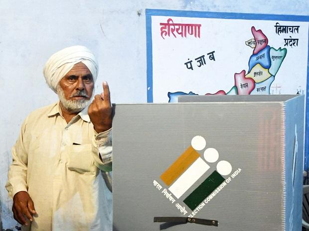 First voter Ajjaib Singh shows his finger after casting vote in Khurkara polling station in Ambala constituency (Photo: PTI)