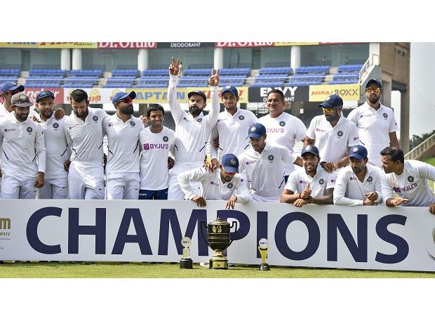 Indian captain Virat Kohli and team players pose with the trophy after winning the Test series against South Africa at JSCA Stadium, in Ranchi. Photo: PTI