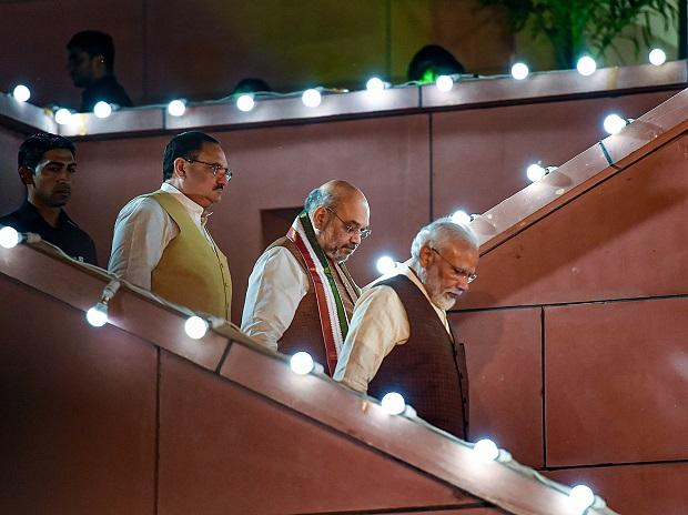 Prime Minister Narendra Modi arrives to address his supporters after the party's victory in both Haryana and Maharashtra Assembly polls, at BJP HQ, in New Delhi, Thursday, Oct 24, 2019. BJP President Amit Shah and BJP Working President JP Nadda are a