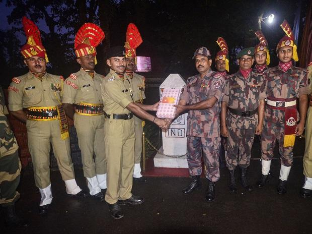 BSF personnel exchange sweets with Border Guard of Bangladesh ahead of Diwali
