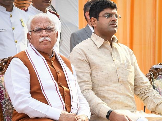 Haryana's new Chief Minister Manohar Lal Khattar and Deputy Cheif Minister Dushyant Chautala after taking oath during a swearing-in ceremony, in Chandigarh, Sunday, Oct. 27, 2019