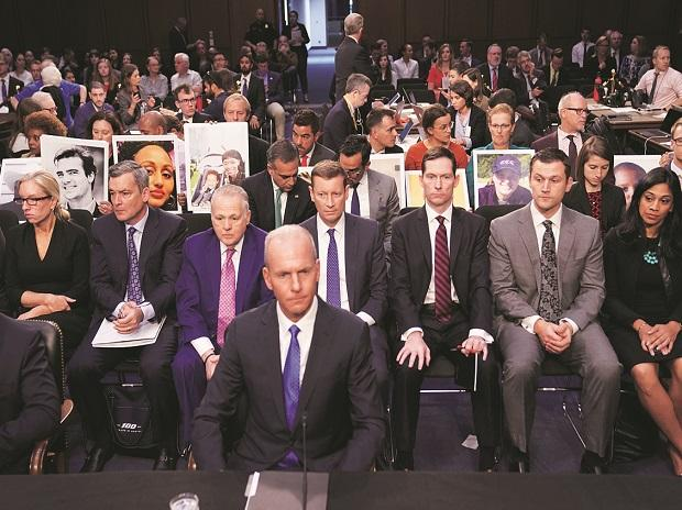 Boeing CEO Dennis Muilenburg (centre) sits in front of family members of Boeing 737 MAX crash victims ahead of the testimony before a Senate Committee. Photo: Reuters