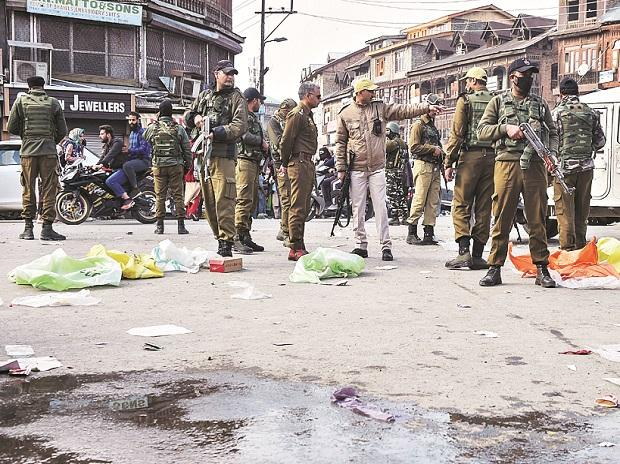 Security officials at the spot of grenade blast at Hari Singh High Street, in Srinagar. Photo: PTI