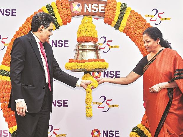 Union Finance Minister Nirmala Sitharaman and Sebi Chairman Ajay Tyagi ring the closing bell to conclude the silver jubilee celebrations of the NSE, in Mumbai on Tuesday 	Photo:PTI