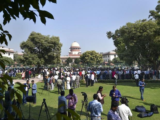 Media personnel in a lawn of the Supreme Court during the pronouncement of the verdict on the Ayodhya case. Photo: PTI