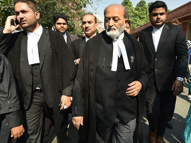 Sunni Waqf Board lawyer Zafaryab Jilani along with other advocates comes out  of the Supreme Court after the Ayodhya case verdict, in New Delhi. Photo: PTI