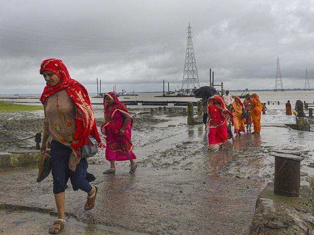 Villagers living in coastal areas being shifted to a shelter home in the wake of the very severe cyclonic storm 'Bulbul'