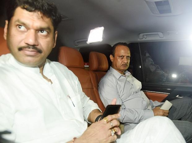 NCP leaders Ajit Pawar and Dhananjay Munde arrive at Raj Bhavan to meet Maharashtra Governor Bhagat Singh Koshyari  in Mumbai. Photo: PTI