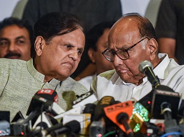 Nationalist Congress Party (NCP) Chief Sharad Pawar and Congress leader Ahmed Patel during a joint press conference, in Mumbai. Photo: PTI