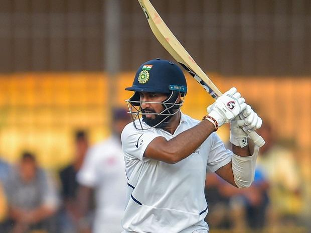 Indian batsman C Pujara plays a shot during the first day of the first Test match between India and Bangladesh, in Indore. Photo: PTI