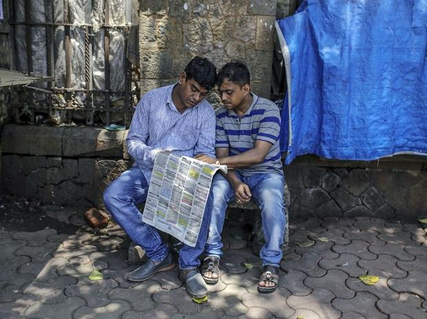 People read the Assignment Abroad Times, a gulf recruitment newspaper, in Mumbai on August 29, 2019. (Dhiraj Singh/ Bloomberg Photo)