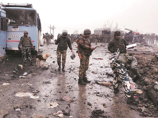 Soldiers examine the site of  an explosion in Pulwama district in February 	Photo: Reuters/file