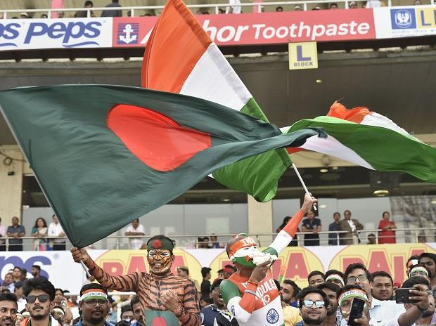 Indian and Bangladesh cricket fans cheer at start of the historic pink-ball day/night cricket test match between the two countries, at the Eden Gardens in Kolkata. Photo: PTI