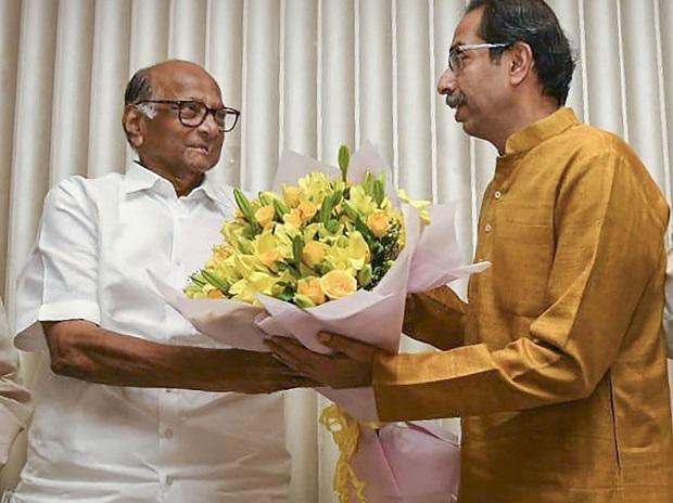 Shiv Sena President Uddhav Thackeray being greeted by NCP chief Sharad Pawar after he was chosen as the nominee for Maharashtra chief minister's post by Shiv Sena-NCP-Congress alliance, during a meeting in Mumbai. Photo: PTI