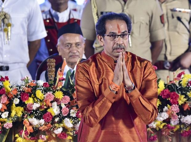 Shiv Sena President Uddhav Thackeray greets his supporters after swearing-in as the Chief Minister of Maharashtra, at Shivaji Park in Mumbai, Thursday, Nov. 28, 2019
