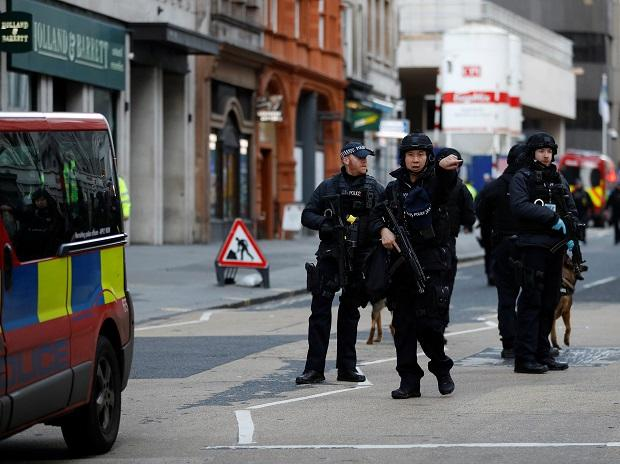 London Police in action after the attack. Photo: Reuters