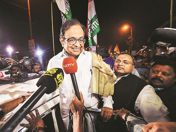 Congress leader P Chidambaram (left) being greeted by party workers after he was released from Tihar jail on Wednesday. Also seen is his son Karti | PHOTO: PTI