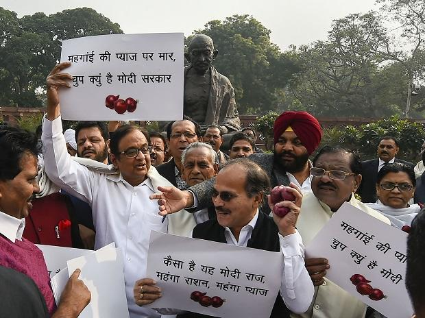 Congress leaders P Chidambaram, Adhir Ranjan Chowdhury and others stage a protest against hike in onion prices at Parliament during the ongoing Winter session, in New Delhi, Thursday, Dec. 5, 2019. (PTI Photo/Kamal Singh)