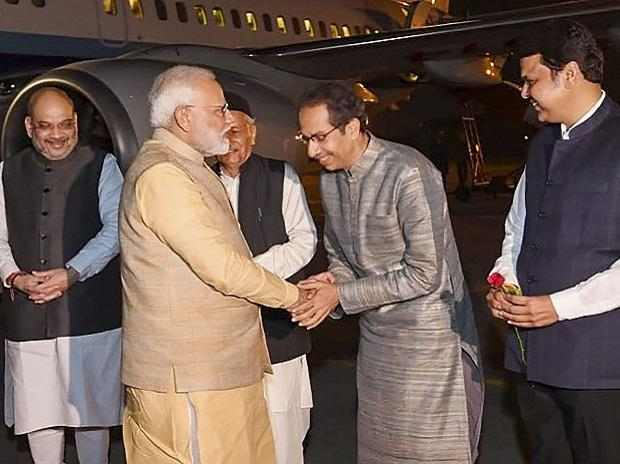 Pune: Prime Minister Narendra Modi being welcome by chief minister of Maharashtra Uddhav Thackeray on his arrives at Pune, Friday, Dec. 6, 2019. (PTI Photo)