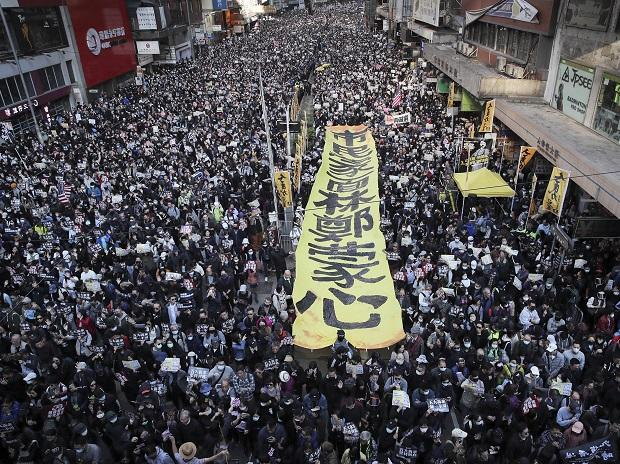 Pro-democracy protesters march on a street during a protest in Hong Kong, Sunday, Dec. 8, 2019 | Photo: PTI
